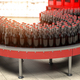 Production of soda bverages or cola. A row of bottles on conveyo - PhotoDune Item for Sale
