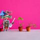 Surprised robot gardener breeder agronomist holding a shovel and rake. - PhotoDune Item for Sale