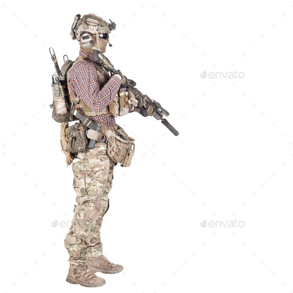 Airsoft player aiming service rifle studio shoot - Stock Photo - Images
