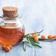Sea buckthorn oil on blue - PhotoDune Item for Sale