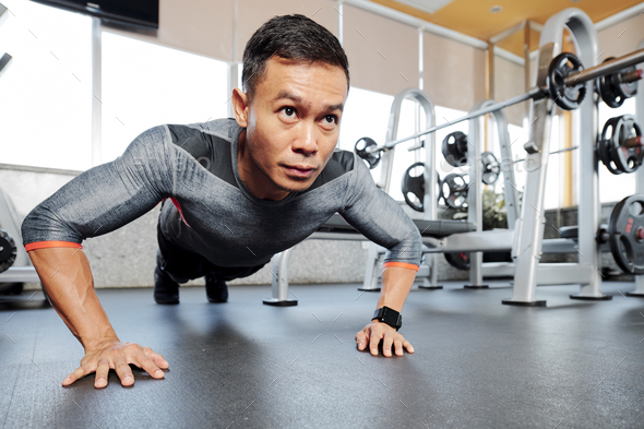 Sportsman doing push-ups - Stock Photo - Images