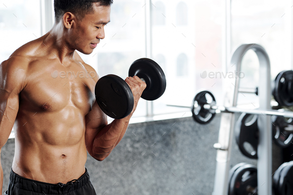 Sportsman working on biceps - Stock Photo - Images