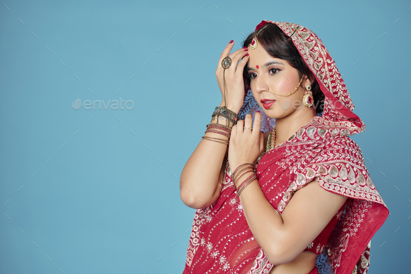 Beautiful woman in traditional sari - Stock Photo - Images