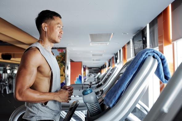Man running on treadmill - Stock Photo - Images