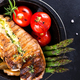 Grilled chicken breast on a cast iron skillet with grill vegetables and green sauce on a stone - PhotoDune Item for Sale