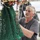 Commercial fisherman mending net. - PhotoDune Item for Sale