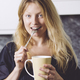 Beautiful blond having coffee in her kitchen - PhotoDune Item for Sale