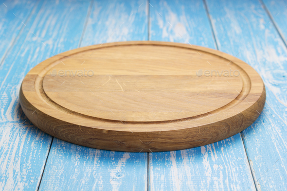 pizza cutting board at rustic wooden table - Stock Photo - Images