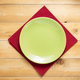 plate and napkin cloth at wooden table background - PhotoDune Item for Sale