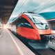 High speed orange train in motion on the railway station - PhotoDune Item for Sale