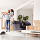 Man Carrying Woman Over Threshold Of New Home On Moving Day - PhotoDune Item for Sale
