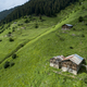 Old Wooden Houses On Green Spring Plain With Fresh Grass - PhotoDune Item for Sale