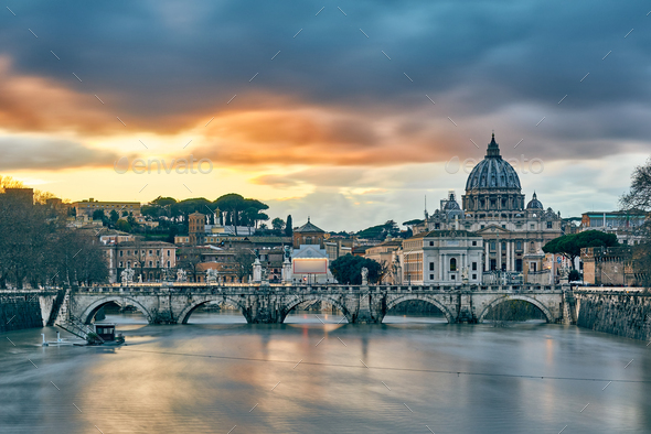 St. Peter's cathedral and Tiber river at evening in Rome - Stock Photo - Images