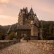 Burg Eltz Castle at sunrise in autumn - PhotoDune Item for Sale