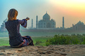 Beautiful girl points to Taj Mahal. Travel concept - PhotoDune Item for Sale
