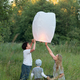 Family of three flying paper lantern outdoor - PhotoDune Item for Sale