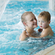 Mother and her son in the swimming pool - PhotoDune Item for Sale