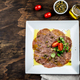 Raw BEEF CARPACCIO on white plate, wooden background, top view - PhotoDune Item for Sale