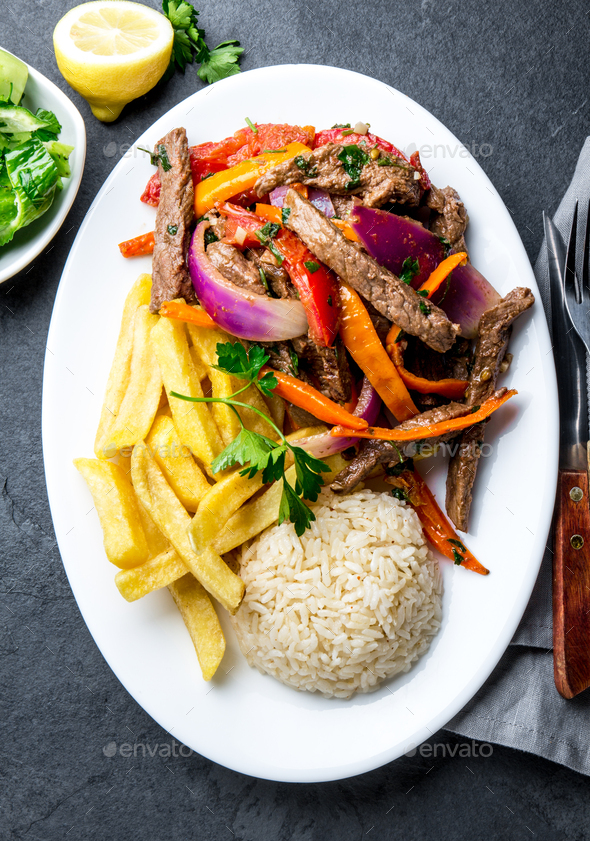 Peruvian dish Lomo saltado - beef tenderloin with vegetables - Stock Photo - Images