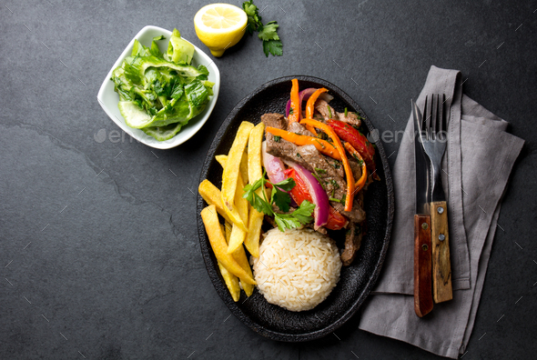 Peruvian dish Lomo saltado - beef tenderloin with vegetables - Stock Photo - Images