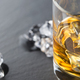 Detail of glass of whiskey and ice cubes shot on the dark background - PhotoDune Item for Sale