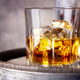 Faceted glass of whiskey with ice - PhotoDune Item for Sale