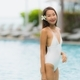 Portrait young asian woman happy smile relax around swimming poo - PhotoDune Item for Sale