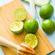 Wooden citrus squeezer and green lime. - PhotoDune Item for Sale