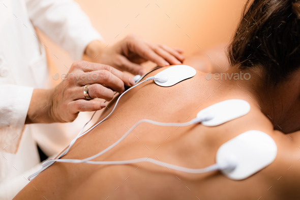 Upper Back Physical Therapy with TENS Electrode Pads, Transcutaneous Electrical Nerve Stimulation - Stock Photo - Images