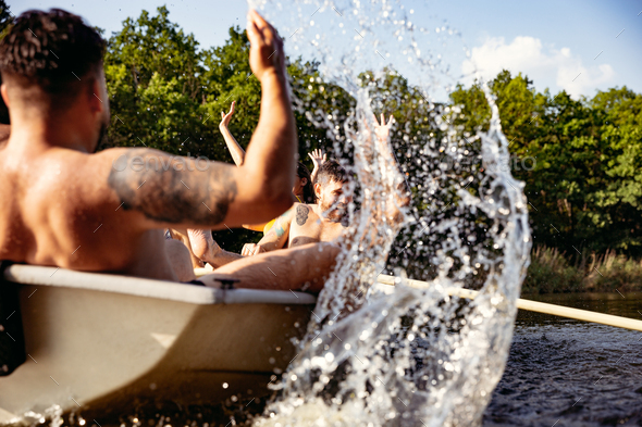 Happy group of friends having fun, laughting and swimming in river - Stock Photo - Images