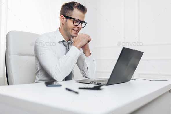 Successful businessman working in his office - Stock Photo - Images