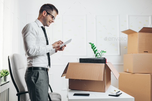 Businessman moving into a new office - Stock Photo - Images