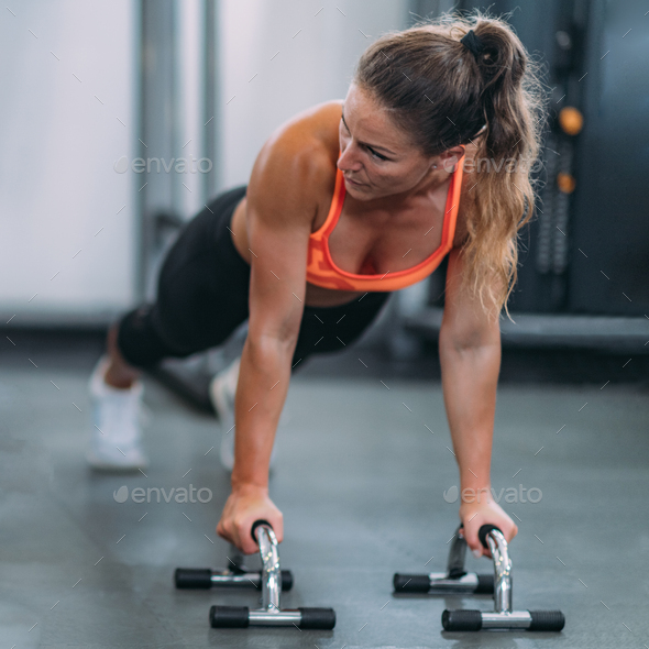 Female Athlete Doing Push-Ups in The Gym - Stock Photo - Images