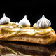 French Artisan Eclair on Black Reflective Background,Copy Space - PhotoDune Item for Sale