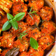 Homemade meatballs with tomato sauce in a white dish baked in the oven with herbs close up - PhotoDune Item for Sale