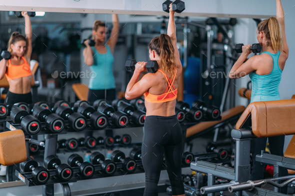 Friends Exercising with Weights in the Gym - Stock Photo - Images