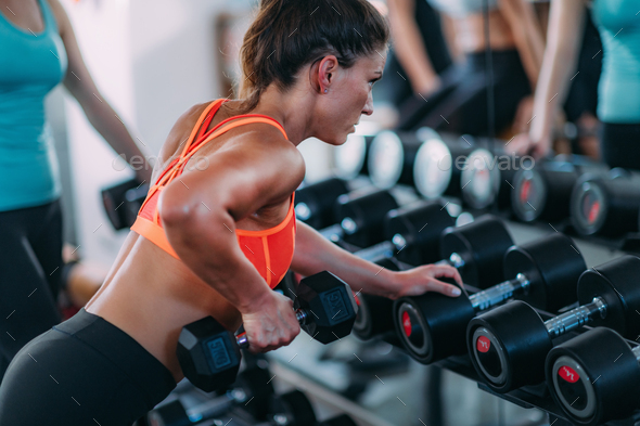 Attractive Female Athlete Exercising in the Gym - Stock Photo - Images