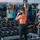 Friends Exercising with Weights in the Gym - PhotoDune Item for Sale