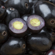 Fresh black Jamun berries full frame and halved ones - PhotoDune Item for Sale