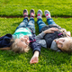 Two smiling kids lying on the grass - PhotoDune Item for Sale