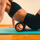 Massaging Lower Back with Foam Roller - PhotoDune Item for Sale