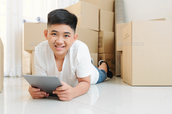 Smiling boy using app on tablet - Stock Photo - Images