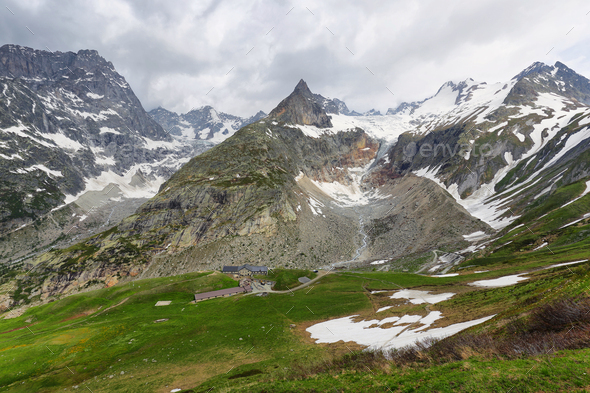 View of mountain peaks with glaciers in Val Ferret, Aosta valley, Italy - Stock Photo - Images
