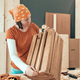 Female carpenter tape measuring wooden crate - PhotoDune Item for Sale