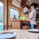 Woman cooking in camper, motorhome interior - PhotoDune Item for Sale