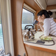 Woman in the interior of a camper RV motorhome with a cup of cof - PhotoDune Item for Sale