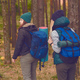 Female travelers with backpacks in the forest - PhotoDune Item for Sale