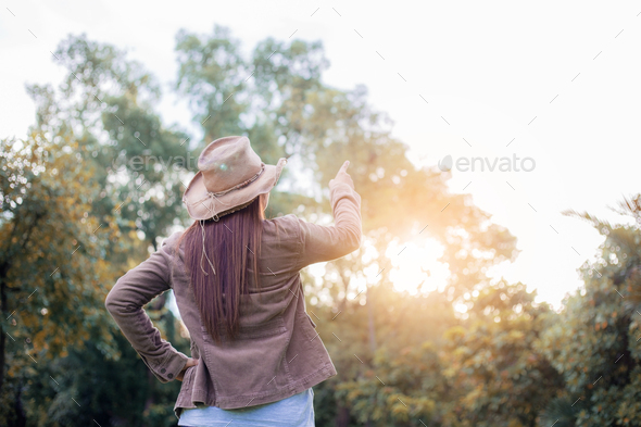 Woman in forest with sunlight - Stock Photo - Images