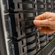Male IT Engineer Replacing Server Drive in SAN At Datacenter - PhotoDune Item for Sale