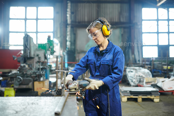 Woman Working in Garage - Stock Photo - Images